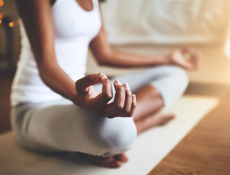 A woman in meditation how to relax at home