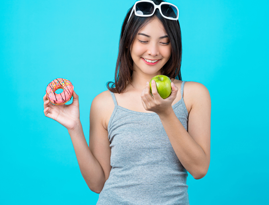 Woman with apple curb food cravings