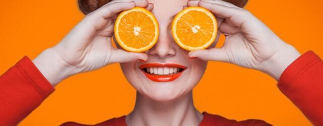 Girl with orange slices over eyes vitamin c immune support