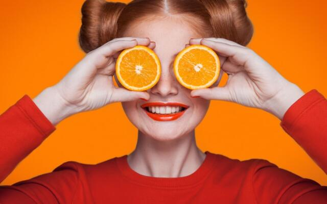 Girl with orange slices over eyes vitamin c immune support