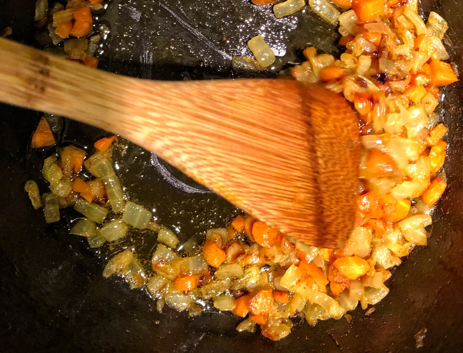 sauteed carrot and onion in pan